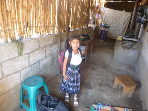 photo of Mayan girl in typical Mayan house