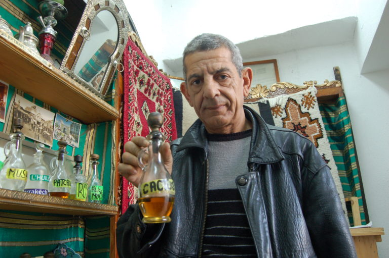 Ali showing his wares in his smal shop in the souk