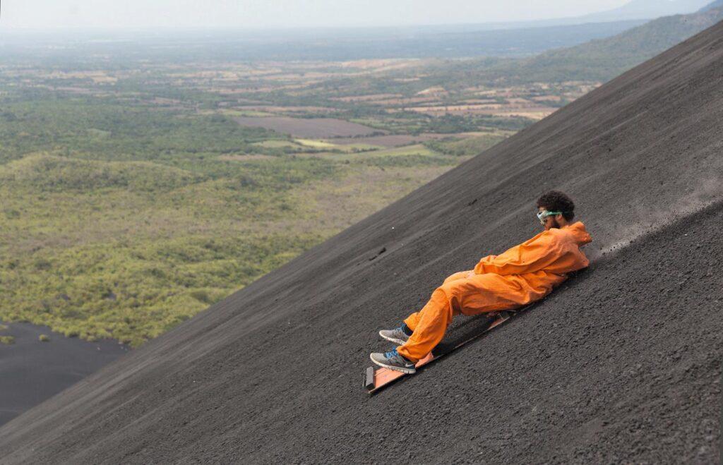A man is volcano boarding down Cerro Negro.
