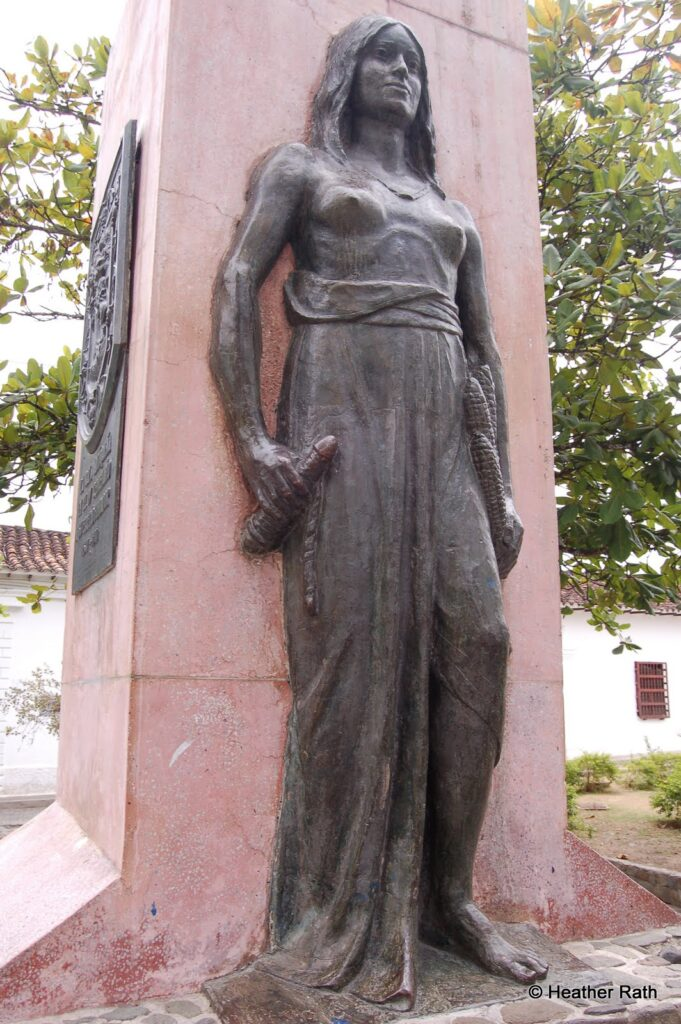 A statue of an Indigenous woman terrorized by the Spaniards